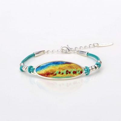 Vista frontal de una pulsera óvalo de la colección Splash con cuero turquesa.